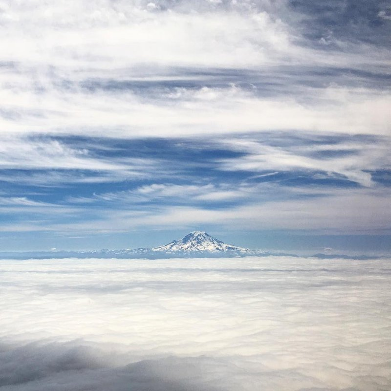 Epic view of Mount St. Helens sticking out of the clouds today